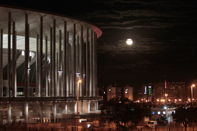View of the National Stadium with moonrise after the third place finish World Cup match between Brazil and the Netherlands, outside the National Stadium in Brasilia, Brazil, Saturday, July 12, 201 ...