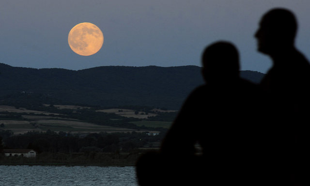 "A perigee moon also known as a supermoon rises above Dojran Lake in southeastern Macedonia, Saturday, July 12, 2014. The phenomenon, which scientists call a ""perigee moon,"" occurs when t ..."