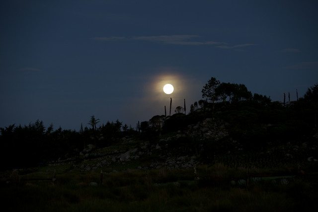 An early morning view of an full moon at Chiantla, in the northern Cuchumatanes mountains of Guatemala, Saturday, July 12, 2014. Because the moon is relatively close to Earth, the full moon today  ...