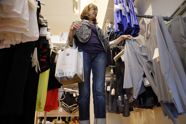 In this photo taken May 14, 2014, Jody Dickman, of Pittsburgh, shops at a Gap store in Pittsburgh. The Commerce Department releases retail sales data for June on Tuesday, July 15, 2014. (AP Photo/ ...