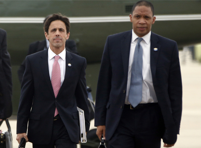 This Oct. 30, 2013, file photo shows David Simas, President Barack Obamas political director, left, and Rob Nabors, Deputy Chief of Staff as they accompany the president to board Air Force One at  ...