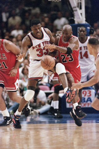 FILE - In this June 3, 1993, file photo, Chicago Bulls, Michael Jordan, right, and New York Knicks'  Patrick Ewing chase a loose ball during the second half of game 5 of the Eastern Conference fin ...
