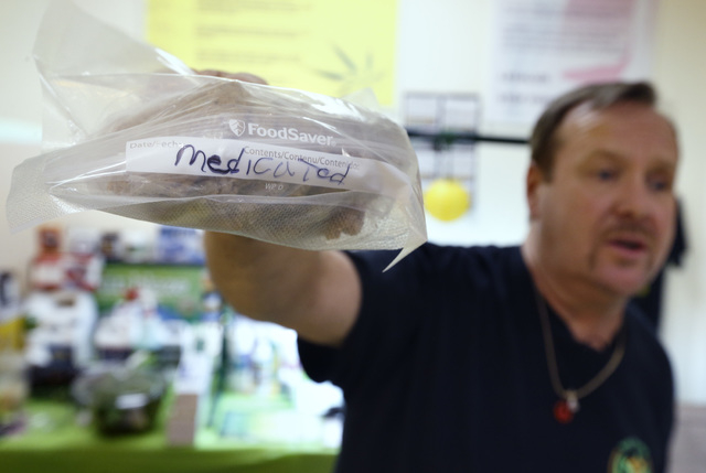 "In this Thursday, July 10, 2014, photo,  Mike Fitzgerald holds a storage bag of cannabis-infused cookies marked ""medicated"" during a cooking class at the New England Grass Roots Institut ..."