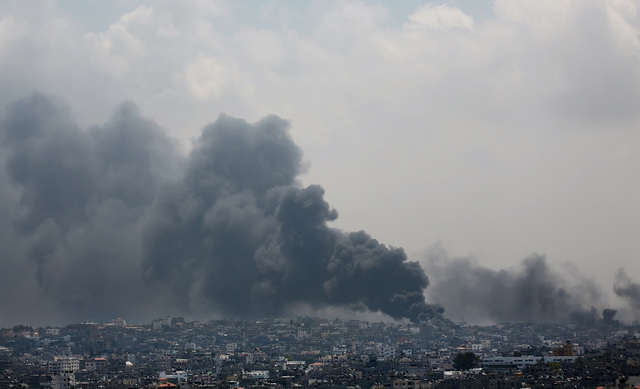 Smoke rises after an Israeli missile hit Shijaiyah neighborhood in Gaza City, northern Gaza Strip, Sunday, July 20, 2014. A Gaza City neighborhood came under heavy tank fire Sunday as Israel widen ...