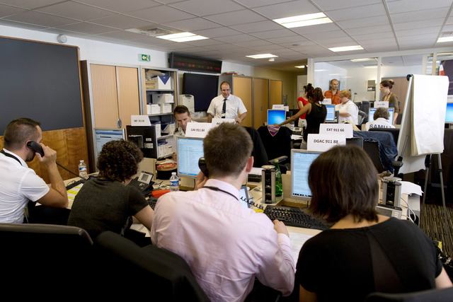 People work in the French Foreign Affairs ministry's crisis center in Paris Friday, July 25, 2014, after a plane crashed in Mali. At least 116 people were killed in Thursdays disaster, nearly half ...