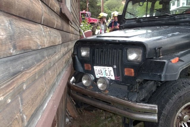 This photo provided by the Myrtle Creek Police Department shows a Jeep that authorities say a toddler crashed into an home in Myrtle Creek, Ore. (AP Photo/Myrtle Creek Police Department)