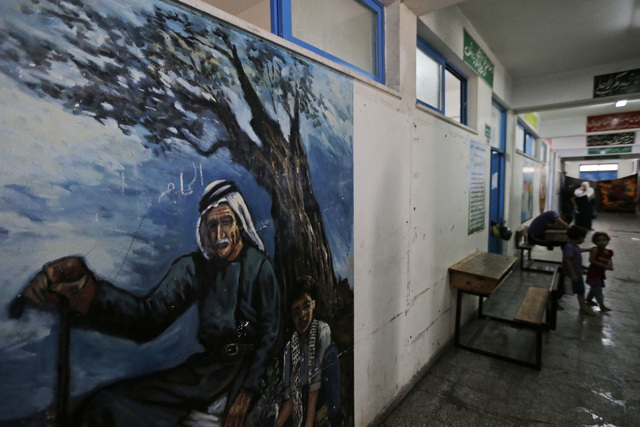 A painting depicting Palestinian rural life decorates a United Nations school where hundreds of families have sought refuge after fleeing their homes following heavy Israeli forces' strikes, in Je ...
