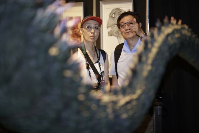 Japanese Godzilla devotees Yoshihiko Horie, right, and his wife Shizue look at a scale model of Godzilla at Godzilla Expo in Tokyo, Friday, July 25, 2014. She feels her life has been defined by Go ...