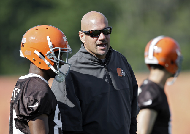 Cleveland Browns head coach Mike Pettine talks with wide receiver Chandler Jones during the first practice at the NFL football team's training camp in Berea, Ohio, Saturday, July 26, 2014. (AP Pho ...