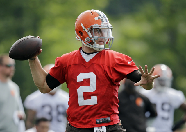 Cleveland Browns quarterback Johnny Manziel (2) passes during the first practice at the NFL football team's training camp in Berea, Ohio Saturday, July 26, 2014. (AP Photo)