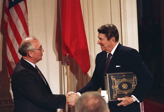 In this Dec. 8, 1997, file photo, U.S. President Ronald Reagan, right, shakes hands with Soviet leader Mikhail Gorbachev after the two leaders signed the Intermediate Range Nuclear Forces Treaty t ...