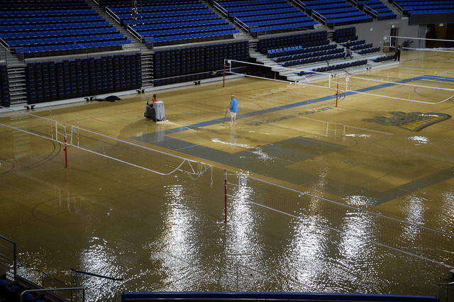 At least an inch of water covers the playing floor at Pauley Pavilion, home of UCLA basketball, after a broken 30-inch water main under nearby Sunset Boulevard caused flooding that inundated sever ...