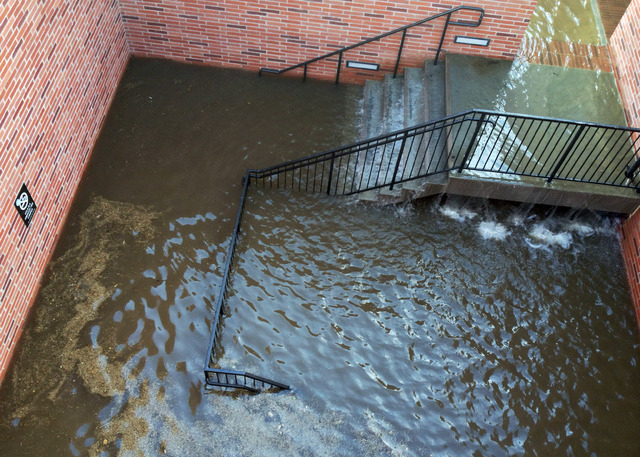 Water has filled the stairs to a parking structure adjacent to the main entry doors of Pauley Pavilion, home of UCLA basketball, after a 30-inch water main burst on nearby Sunset Boulevard Tuesday ...
