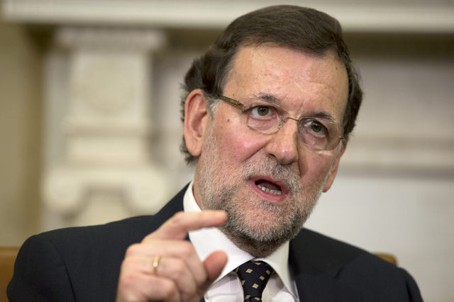 FILE - In this Jan. 13, 2014 file photo, Spanish Prime Minister Mariano Rajoy speaks during a meeting with U.S. President Barack Obama in the Oval Office of the White House in Washington. Rajoy an ...