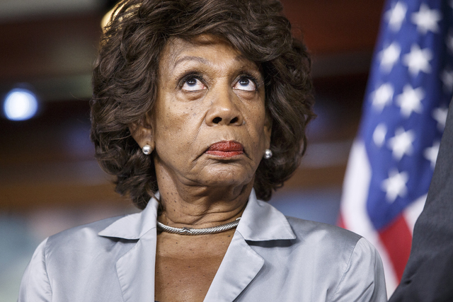 Rep. Maxine Waters, D-Calif., listens to comments by House Minority Whip Steny Hoyer of Md., as she and fellow Democrats criticize the efforts of Republicans to muscle legislation through the Hous ...