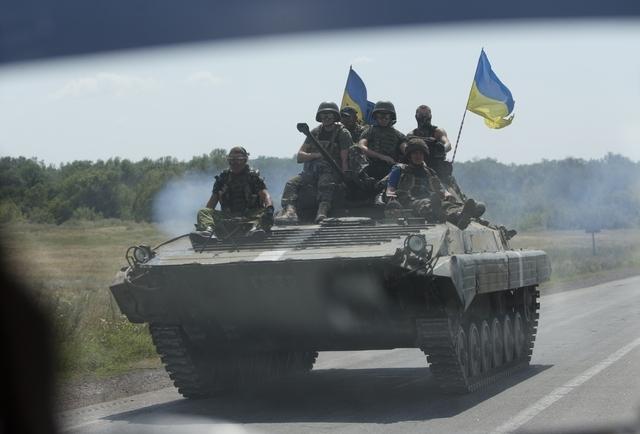 Ukrainian troops move near the village of Debaltseve, Donetsk region, eastern Ukraine, Thursday, July 31, 2014. (AP Photo/Dmitry Lovetsky)