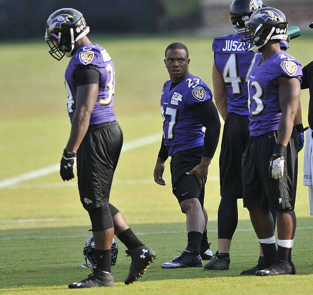 Baltimore Ravens running back Ray Rice, center, stretches before NFL football training camp practice, Thursday, July 31, 2014, in Owings Mills, Md.(AP Photo/Gail Burton)