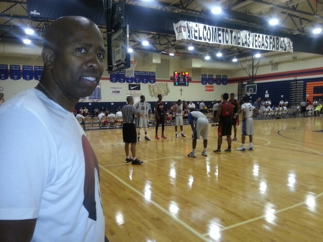 "NBA analyst Kenny ""The Jet"" Smith stops to pose while watching his AAU team - Aim High - participate in the Las Vegas Fab 48 at Gorman High School. (By W.G. Ramirez)"