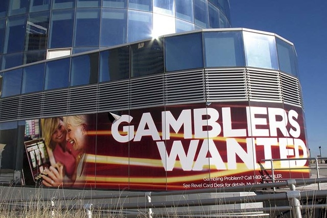 "A banner outside Revel Casino Hotel in Atlantic City N.J. touting its ""Gamblers Wanted"" promotion to help drum up new business. (AP Photo/Wayne Parry)"