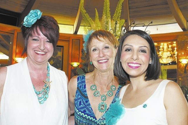 From left, chairwomen Jeanette Williams and Annette Kinsman of American Lung Association stand with auction chairwoman Melina Gluck at the association's fourth annual Swing into Summer Fashion S ...