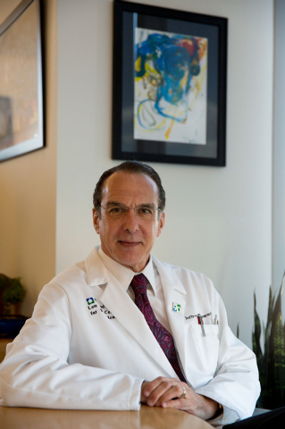 Doctor Jeffrey Cummings, director of The Cleveland Clinic Lou Ruvo Center for Brain Health, poses inside his office at the center Tuesday, July 1, 2014. Cummings released a study that shows 99.6 p ...