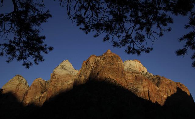 Shadows creep up on sandstone cliffs as the sun sets on Zion National Park near Springdale, Utah. (AP File Photo/Julie Jacobson)