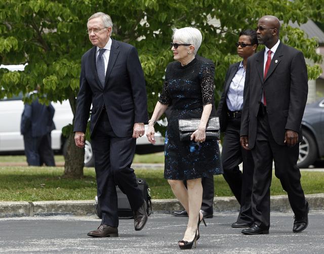 Senator Harry Reid and his wife, Landra Gould, arrive to attend the funeral of former Tennessee Senator Howard Baker, Jr. Tuesday, July 1, 2014, in Huntsville, Tenn. (AP Photo/Wade Payne)