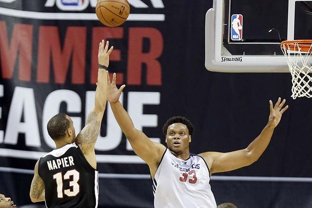 Washington Wizzards' Daniel Orton (33) covers a shot from Miami Heat's Shabazz Napier (13) during the first half of an NBA summer league basketball game Tuesday, July 15, 2014, in Las Vegas. Washi ...