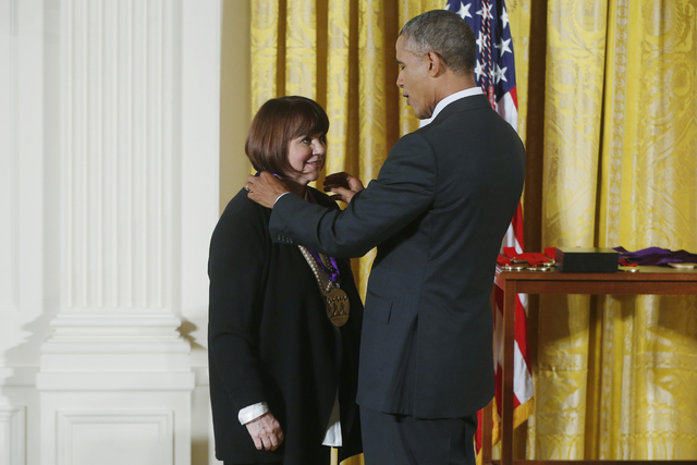 President Barack Obama awards the 2013 National Medal of Arts to Linda Ronstadt during a ceremony in the East Room at the White House in Washington on July 28, 2014. (AP Photo/Charles Dharapak)