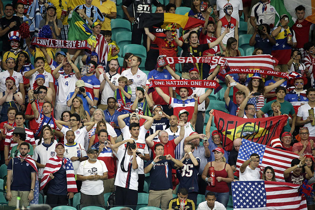 US fans cheer their team after the World Cup round of 16 soccer match between Belgium and the USA at the Arena Fonte Nova in Salvador, Brazil, Tuesday, July 1, 2014. Belgium held on to beat US 2-1 ...