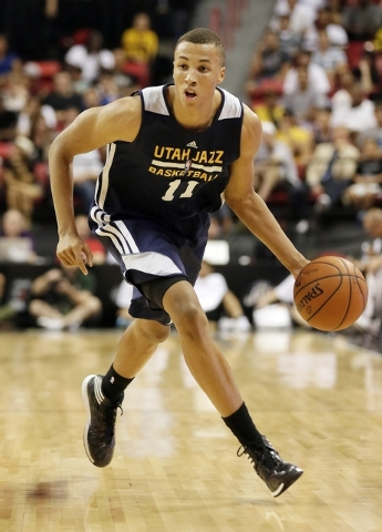 Utah Jazz's Dante Exum drives up the court against the Milwaukee Bucks during the first half of an NBA summer league basketball game Monday, July 14, 2014, in Las Vegas. (AP Photo/John Locher)
