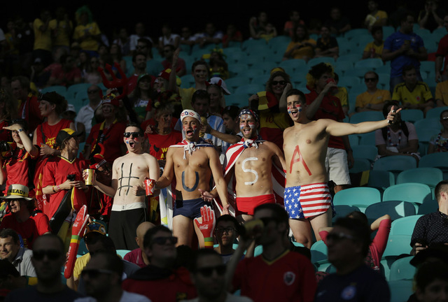 US fans cheers before the World Cup round of 16 soccer match between Belgium and the USA at the Arena Fonte Nova in Salvador, Brazil, Tuesday, July 1, 2014. (AP Photo/Felipe Dana)