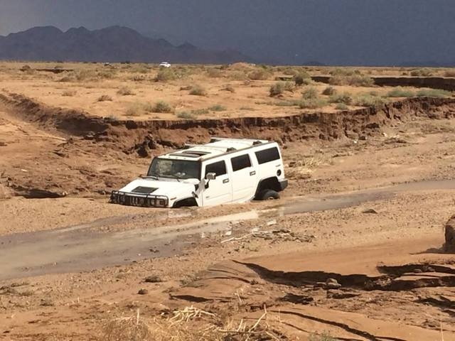Patrick Moore, Northern Arizona Consolidated Fire District Chief, said force of the water running through the wash swept a Hummer H-2 about a quarter of a mile in a violent monsoon storm on Monday ...
