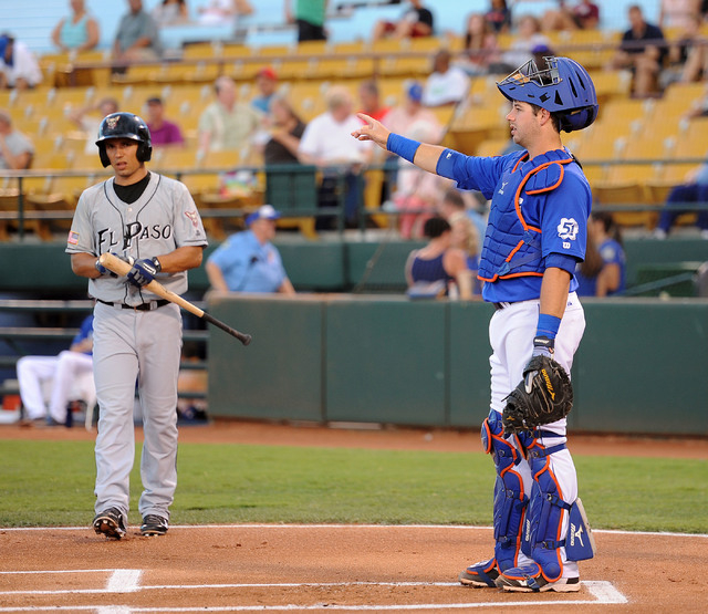 Las Vegas 51s catcher Kevin Plawecki points to right field as El Paso Chihuahuas' Jace Peterson come up to bat at Cashman Field, Thursday, July 30, 2014, (Jerry Henkel/Las Vegas Review-Journal)