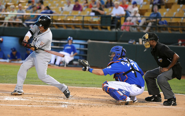 Las Vegas 51s catcher Kevin Plawecki watches as El Paso Chihuahuas' Taylor Lindsey swings at a pitch at Cashman Field, Thursday, July 30, 2014, (Jerry Henkel/Las Vegas Review-Journal)