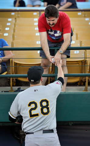 Salt Lake relief pitcher Kyler Newby (28) signs an autograph for Jeff Levin before a minor league baseball game against the Las Vegas 51s at Cashman Field on Monday, June 30, 2014. (David Becker/L ...