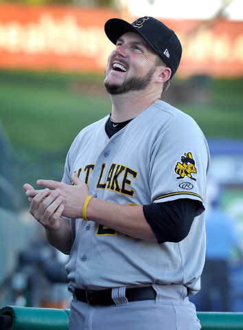 Salt Lake relief pitcher Kyler Newby smiles as he speaks with fans before a minor league baseball game against the Las Vegas 51s at Cashman Field on Monday, June 30, 2014. (David Becker/Las Vegas  ...