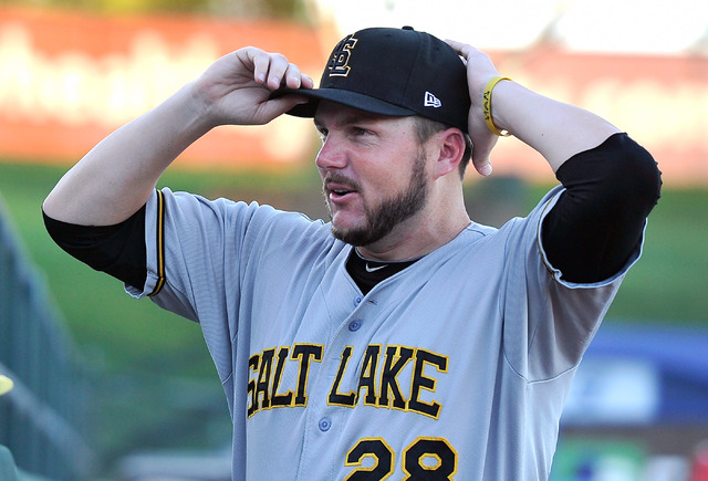 Salt Lake relief pitcher Kyler Newby adjusts his hat as he speaks with fans before a minor league baseball game against the Las Vegas 51s at Cashman Field on Monday, June 30, 2014. (David Becker/L ...