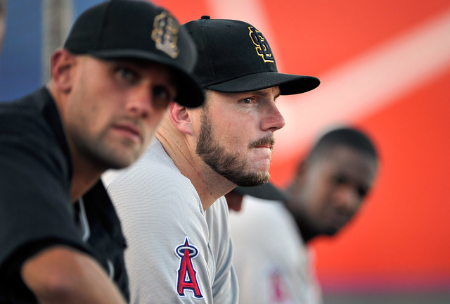 Salt Lake relief pitcher Kyler Newby, center watches the action during a minor league baseball game against the Las Vegas 51s at Cashman Field on Monday, June 30, 2014. (David Becker/Las Vegas Rev ...