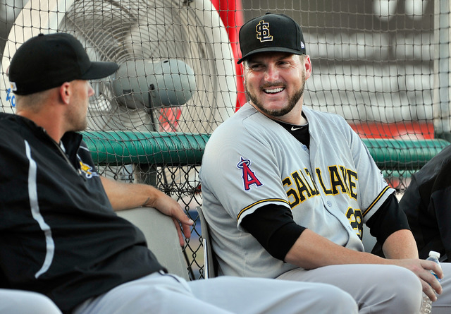 Salt Lake relief pitcher Kyler Newby, right, smiles as he speaks with a teammate before a minor league baseball game against the Las Vegas 51s at Cashman Field on Monday, June 30, 2014. (David Bec ...