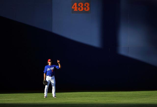 Las Vegas center fielder Matt denDekker calls two outs during the first inning of a minor league baseball game against the Salt Lake Bees at Cashman Field on Monday, June 30, 2014. (David Becker/L ...