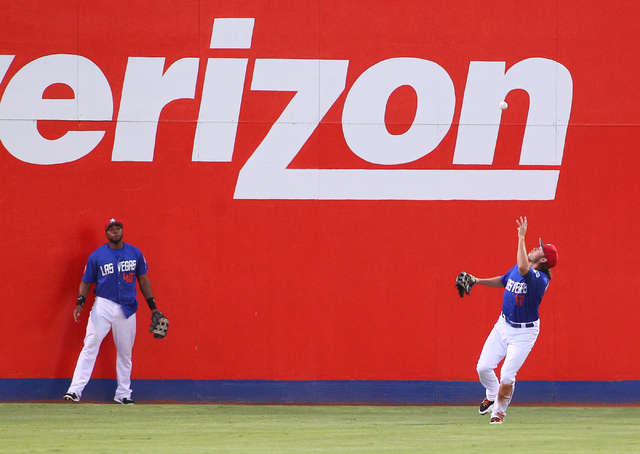 Las Vegas 51s' Matt den Dekker, right, looks to catch a ball after it bounced on the ground from Salt Lake Bees' Luis Jimenez, not pictured, while Brandon Allen looks on during a baseball game at  ...