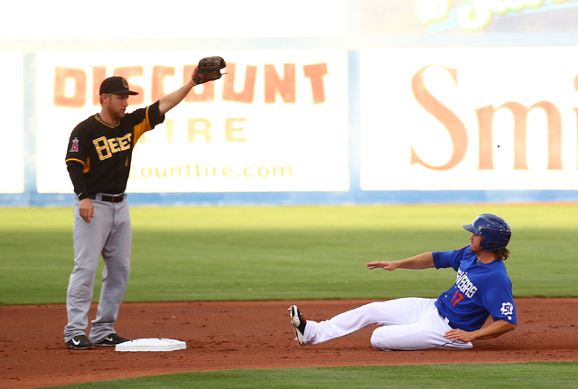 Las Vegas 51s' Matt den Dekker, right, slides safely into second base as Salt Lake Bees' Taylor Lindsey waits for the throw during a baseball game at Cashman Field in Las Vegas on Tuesday, July 1, ...