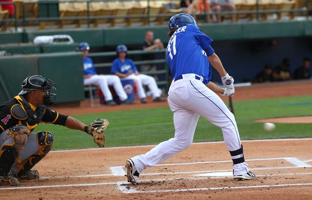 Las Vegas 51s' Matt den Dekker hits a single against the Salt Lake Bees during a baseball game at Cashman Field in Las Vegas on Tuesday, July 1, 2014. (Chase Stevens/Las Vegas Review-Journal)