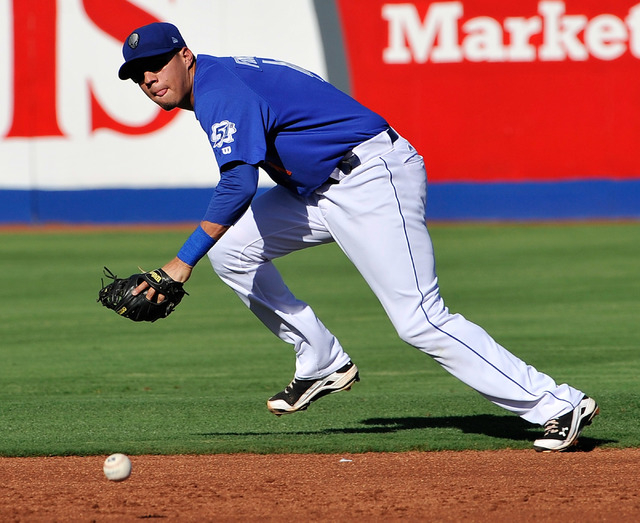 Las Vegas 51s second baseman Wilmer Flores runs for the ball during a baseball game against the Albuquerque Isotopes at Cashman Field on Friday, July 11, 2014. Flores was named the Pacific Coast L ...