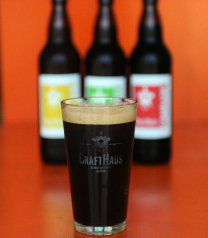 A glass of beer is seen in front of three bottles at CraftHaus Brewery in Henderson, Friday, July 11, 2014. CraftHaus is slated to open in late summer or early fall. (Jerry Henkel/Las Vegas Review ...