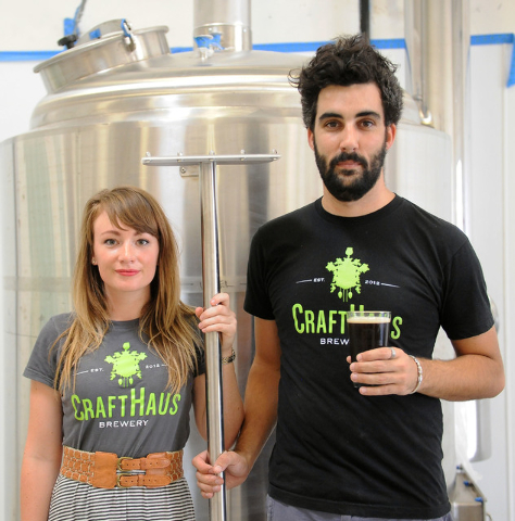 Steph Cope, head brewer, and Steve Brockman, research and development brewer, stand in front of a condenser tank at CraftHaus Brewery in Henderson, Friday, July 11, 2014. CraftHaus is slated to op ...