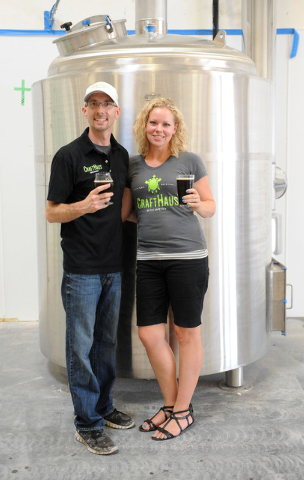 Owners Dave and Wyndee Forrest stand in front of a condenser tank at CraftHaus Brewery in Henderson, Friday, July 11, 2014. CraftHaus is slated to open in late summer or early fall. (Jerry Henkel/ ...