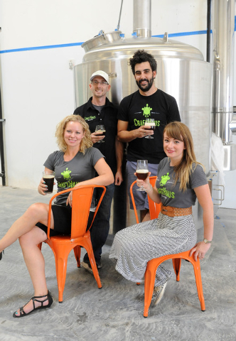 Owner Dave Forrest, upper left, and research and development brewer Steve Brockman, upper right, join owner Wyndee Forrest, lower left, and Steph Cope, head brewer, lower right, for a photo at Cra ...