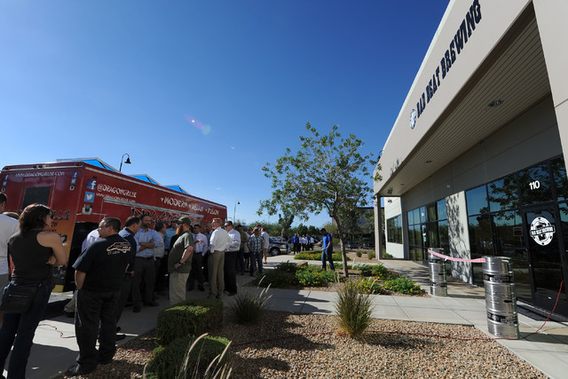 People wait for the grand opening at Bad Beat Brewing in Henderson, Friday, July 11, 2014. The brew house opened on Friday to large crowds.  (Jerry Henkel/Las Vegas Review-Journal)